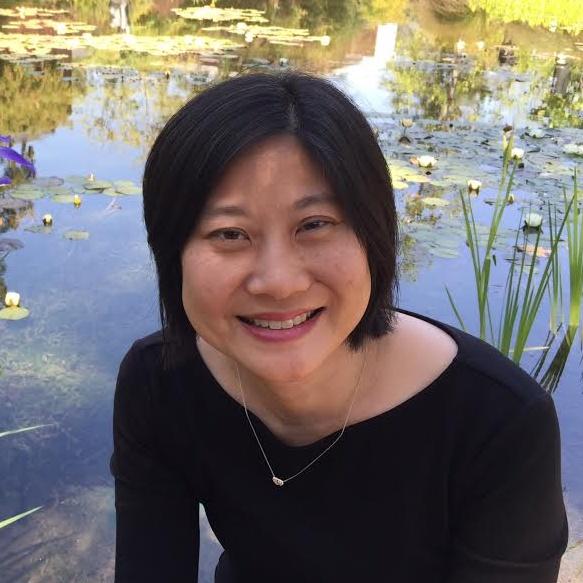 Julie Ha filmmaker headshot (with pond in background)