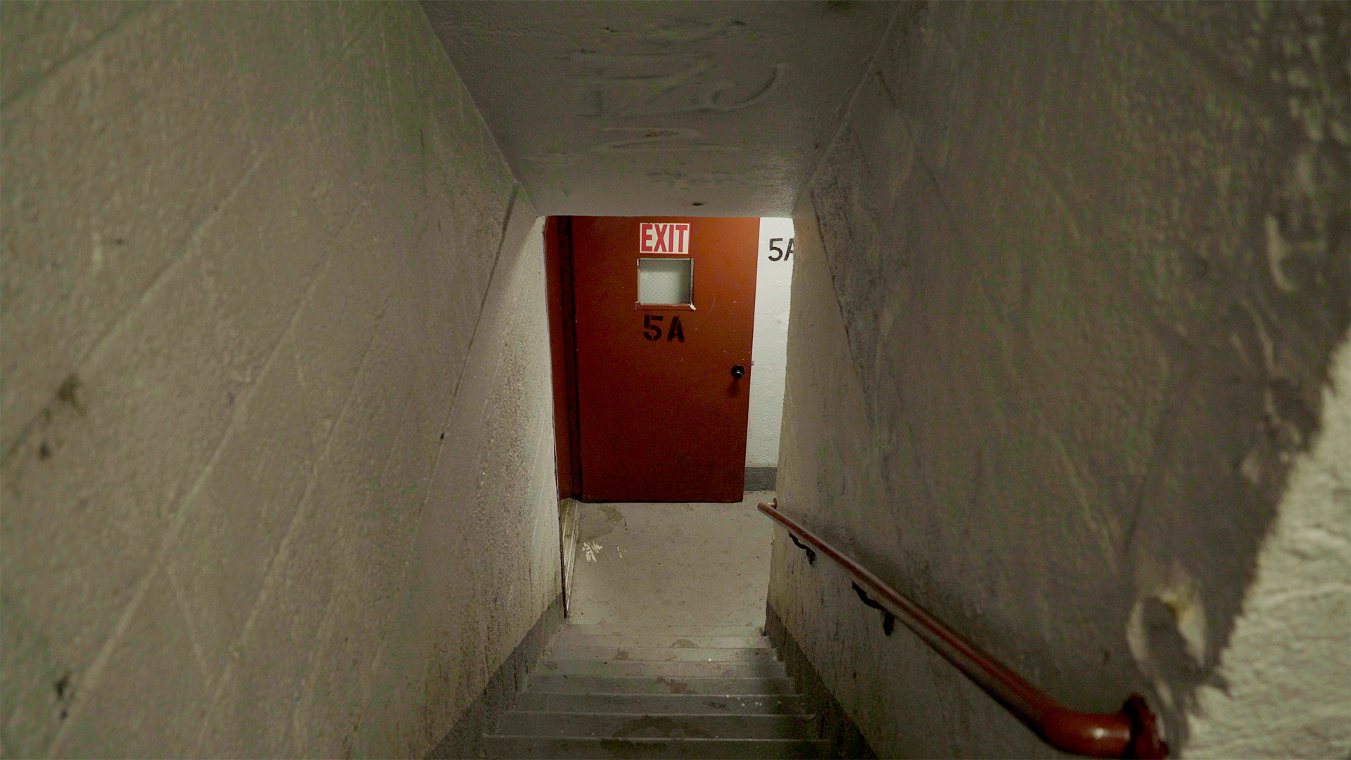1downdarkstai 1 5 pubstill dds pubstill 007 pinkhouses stairwell5a